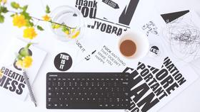 Medium computer keyboard and paper designs in office
